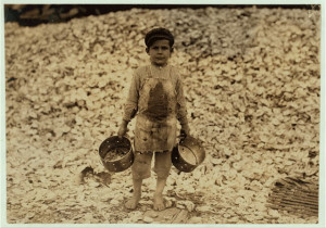 Manuel, the young shrimp-picker, five years old, and a mountain of ...