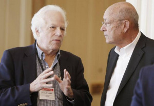 Dr Stanley B Prusiner left and Walter Rainwater talk during a semi
