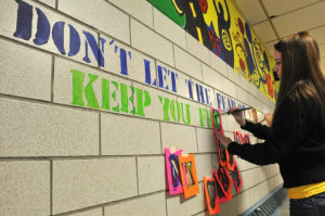 Easthampton High School sophomore Marisa Dineen paints the words