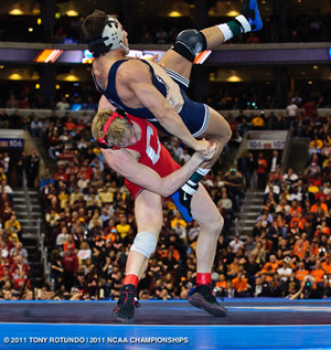 Cornell's Kyle Dake lifts Penn State's Frank Molinaro on his way to ...