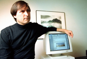 Steve Jobs, co-founder of Apple Computer, talks in a conference room ...