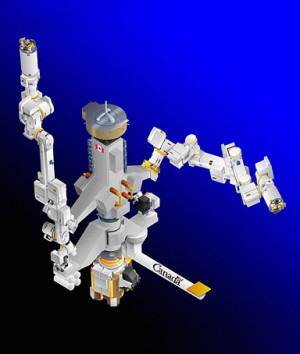 Astronaut Garrett Reisman, on the the 12-foot-tall robot Dextre, which ...