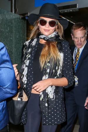 Chrissy Teigen Arrives at LAX airport in LA