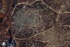 The Wall around Qalqiliya, where it imprisons 100,000 Palestinians in ...