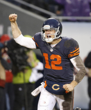 Bears quarterback Josh McCown runs to the sidelines after a Matt Forte ...
