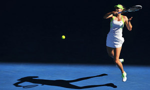Maria Sharapova of Russia plays a stroke during her semi-final victory ...
