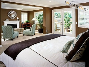 Contemporary Master Bedroom with Sitting Area by Fireplace photo