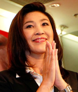 ... Phue Thai party's Yingluck Shinawatra gives Thai traditional