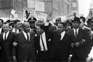 ... second from right, marched with UAW President Walter P. Reuther, left