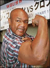 As he marched purposely off stage, motivational speaker George Foreman ...