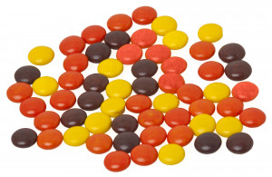 reese s pieces are small crispy candies surrounding a peanut butter ...