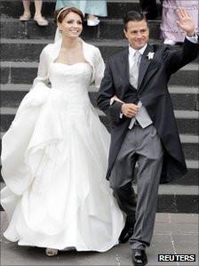 Enrique Pena Nieto walks with his wife, actress Angelica Rivera, after ...