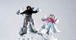 Hayley Smyers, 14, and Olivia Lutes, 3, make snow angels in Hutchinson ...