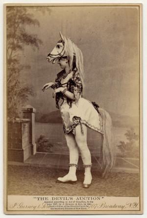 Eliza Blasina wearing horse-head headdress, short costume with ...