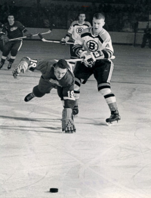 ... Photos > 1966 > 1966-Tipping Paul Henderson Of The Detroit Red Wings