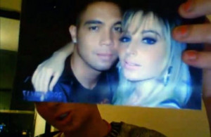Tulisa Contostavlos holds up a picture of her and ex-boyfriend Justin ...
