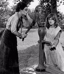 ... Sullivan (Bancroft) at the water pump with Helen Keller (Patty Duke