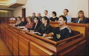 Harris County District Clerk Chris Daniel holding jury summons