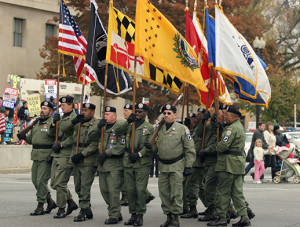 Vietnam veterans group marches in the parade to celebrate the 25th ...