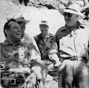 John Wayne and John Ford enjoy a laugh in Monument Valley while ...