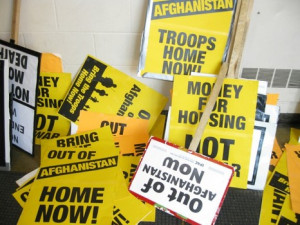 Multiple anti-war signs with pro-peace quotes left in a pile near the ...