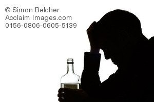 ... Silhouette of a Depressed Man Struggling With His Alcohol Addiction