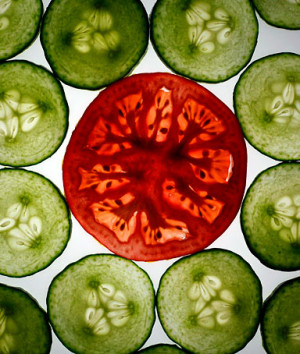Slices of cucumber and a tomato slice are pictured in this ...