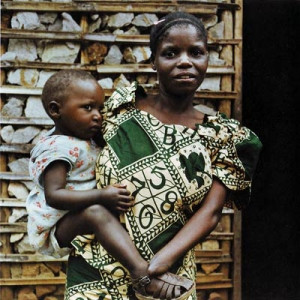 Jeannette with her baby. Her hands were cut off by rapists. © 2006 ...