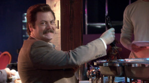 Ron Swanson serving himself some bacon