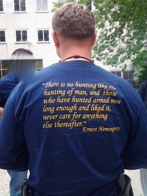 ... officer wearing a t-shirt with a pretty disturbing quote from Ernest