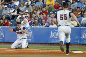 Mud Hens first baseman Mike Hessman throws to pitcher Tim Melville at