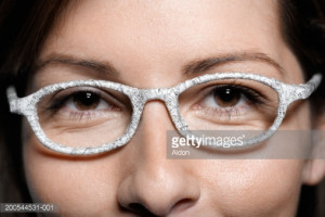 Stock Photo : Woman wearing glasses wrapped in stock quotes, close-up ...