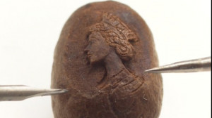 Thread: Micro-portrait of the Queen carved onto a coffee bean - BBC