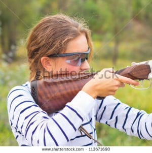 gun for trap shooting and shooting glasses aiming at a target - stock ...