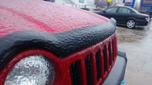freezing rain resulted in a solide layer of ice covering every car