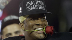 Florida State's Jameis Winston holds rose in his mouth after NCAA BCS ...