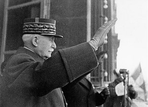 Marshal Pétain greets his supporters with a Nazi salute.