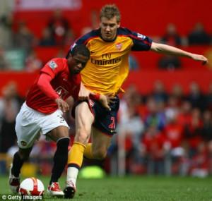 Arsenal striker Nicklas Bendtner (right) tussles with Patrice Evra of ...