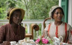 Lupita Nyong'o (l.) as Patsey and Alfre Woodard as Mistress Shaw in ...