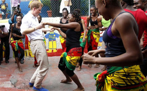 Prince Harry dances with Dormer at a youth community centre during his ...