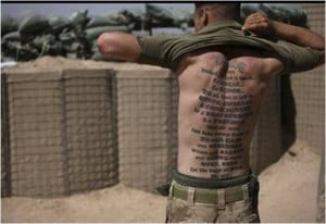 Marines tattoo on his back reads: