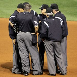 Umpire Huddles=Baseball Tradition