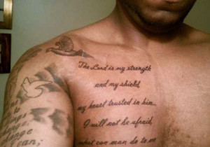 ... arm and chest of the guy are covered with his favorite bible verses