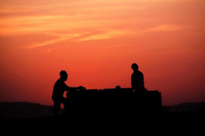 AP Oil field workers prepare a new site in the desert oil fields of ...