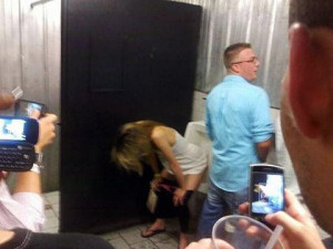 These guys act like they've never seen a girl peeing in a men's ...