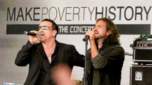 Bono from U2 and Eddie Vedder from Pearl Jam perform at a 'Make ...