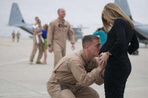 expecting mom welcomes home her soldier with a surprise maternity ...