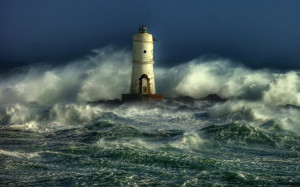 Old lighthouse standing in storm