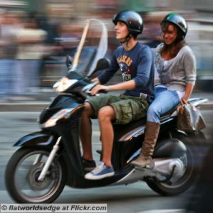 Young-Italian-Couple-Enjoying-A-Scooter-Ride.jpg