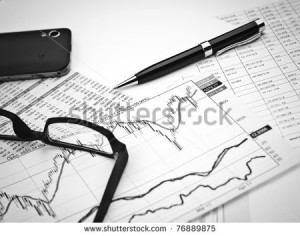 ... on the charts and quotes prints, the smart phone, eyeglasses and a pen